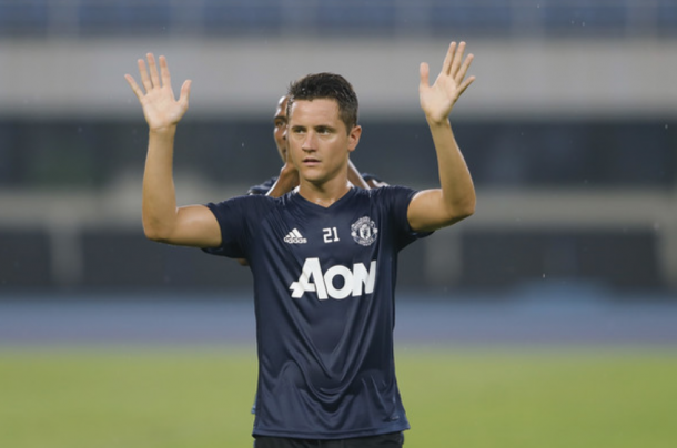 Ander Herrera waves to fans during the training session before the cancelled Derby (Lintao Zhang/Getty)