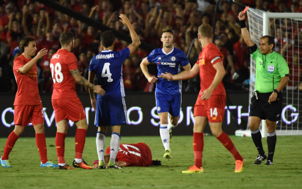 Fabregas receives a straight red card for lunging in on Klavan, down on the turf. (Picture: Yahoo Sports)