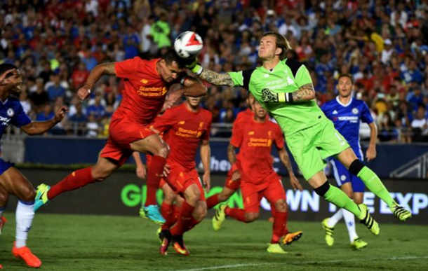Karius and Lovren come together in the incident that left the 'keeper's hand damaged. (Picture: Getty Images)