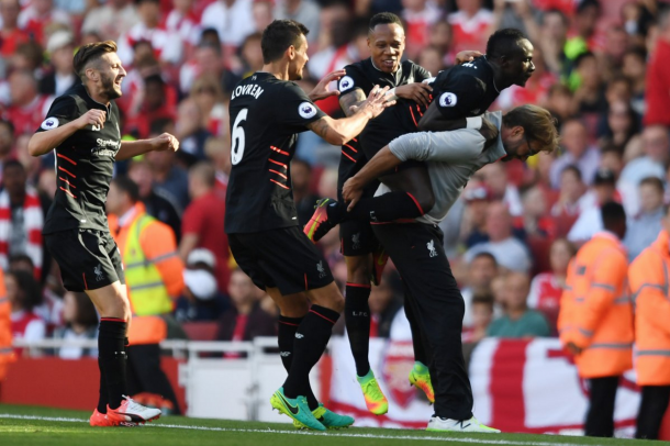 Mane celebrates his goal away at Arsenal with Klopp and his teammates. (Picture: Getty Images)