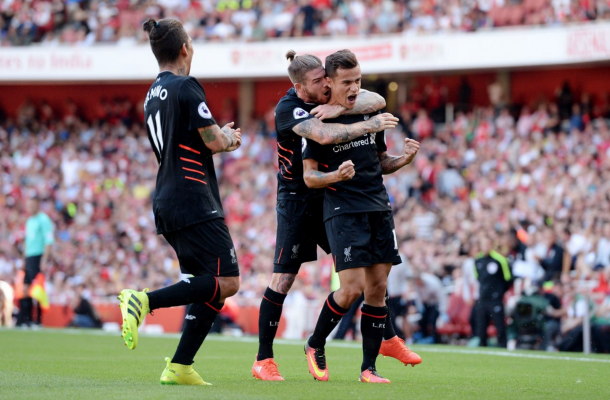 Coutinho celebrates after his stunning long-range free-kick made it 1-1 on Sunday. (Picture: Getty Images)