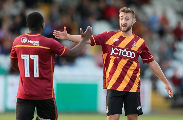 Vincent Rabiega (right) celebrates after scoring against Bradford Park Avenue. (Photo: Bradford City AFC)