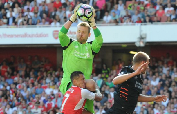 Mignolet comes out to claim a cross at the Emirates on Sunday. (Picture: Liverpool Echo via Getty Images)