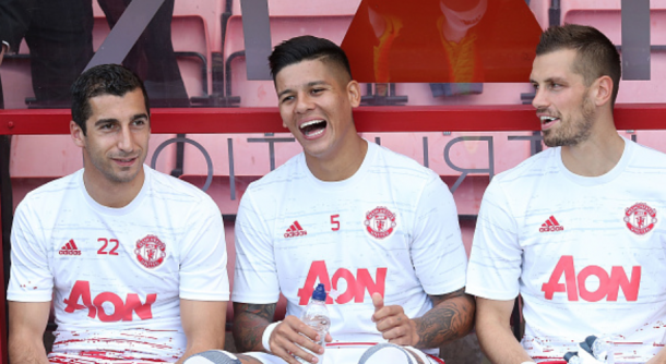 Mkhitayran (L) was on the bench for the first two United games of the season (John Peters/Getty Images)