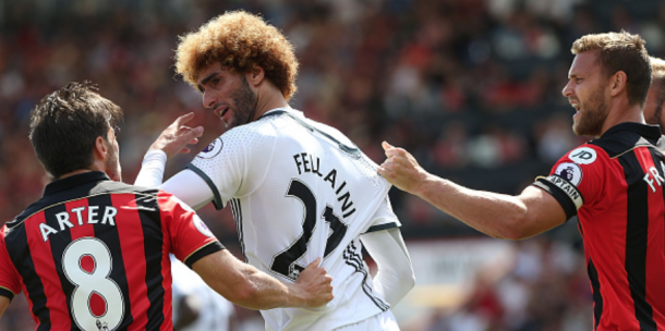 Fellaini getting into it with Harry Arter (John Peters/Getty Images)