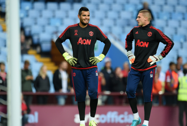 Romero and Johnstone (R) warming up before last season's Premier League against Aston Villa (Michael Regan/Getty)