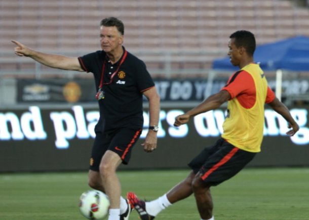 Nani getting instruction from Louis van Gaal (John Peters/Getty Images)