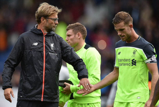 Klopp consoles captain Jordan Henderson after the full-time whistle. (Picture: Getty Images)