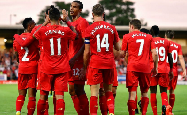 The Liverpool squad celebrate together after Firmino's header made it 2-0. (Picture: Liverpool FC via Getty Images)