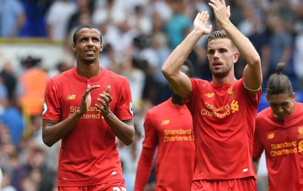 Matip joins his teammates to thank the away supporters after full-time. (Picture: Getty Images)
