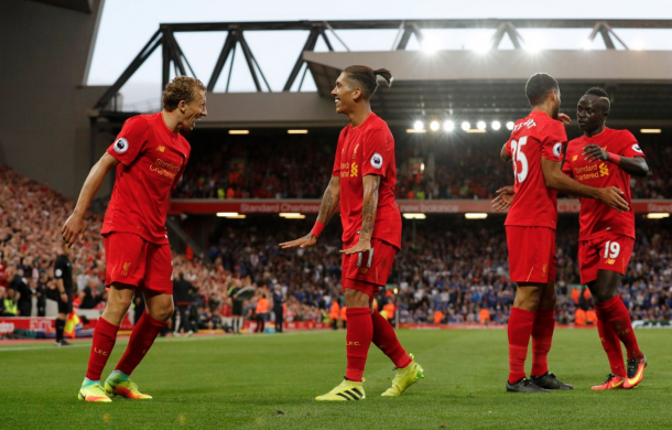 Liverpool celebrate Firmino's late goal to make it 4-1. (Picture: Getty Images)