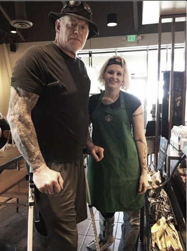 The Undertaker was snapped needing crutches to get around (image: twitter.com)