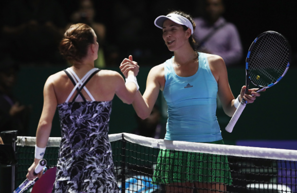 Radwanska and Muguruza shake hands after their match (Julian Finney/Getty Images)