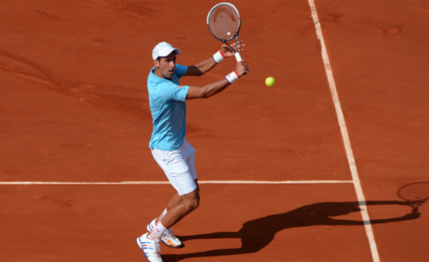 Once again, the light colors of Djokovic's outfit work lovely with the red clay (Ilewig Christian/Getty Images/Action Sport)