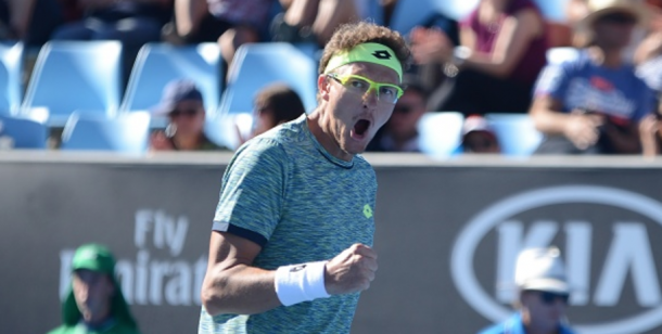 Denis Istomin celebrates his win over Pablo Carreno Busta (Anadolu Agency/Getty Images)