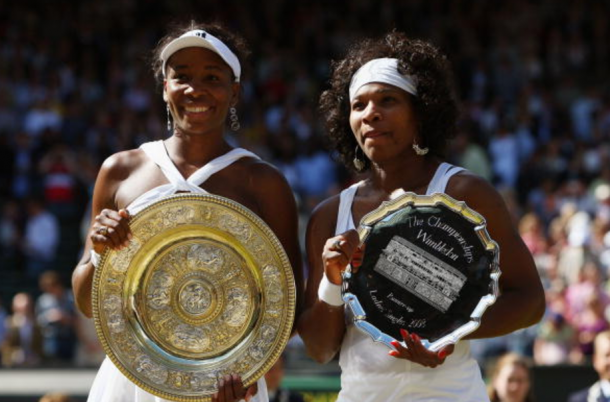 Venus and Serena pose with their trophies during the 2008 Wimbledon Final (Ryan Pierse/Getty Images)