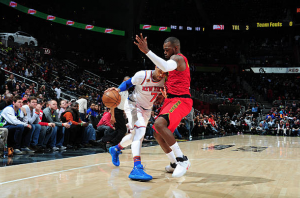Paul Millsap and Carmelo Anthony duked it out in one for the ages. (Photo by Scott Cunningham/Getty Images)