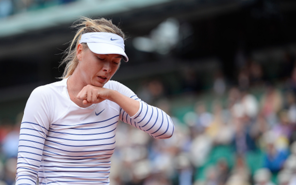 A dejected Maria Sharapova reacts after her last match at the French Open (Aurelien Meunier/Getty Images)