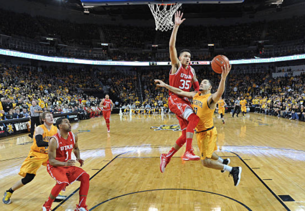 Kuzma showcasing his length against Wichita State. (Photo by Peter Aiken/Getty Images)