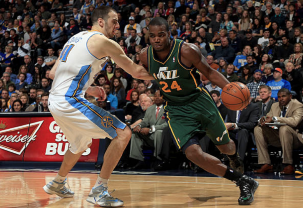 Millsap facing off against the Nuggets as a member of the Utah Jazz in 2013. (Photo by Doug Pensioner/Getty Images)