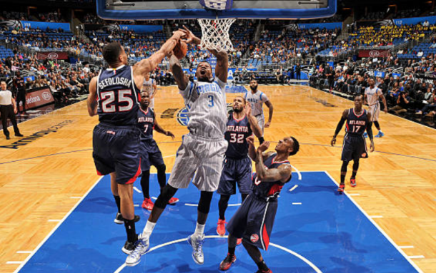 Dedmon playing against the Hawks as a member of the Orlando Magic in 2014. (Photo by Fernando Medina/Getty Images)