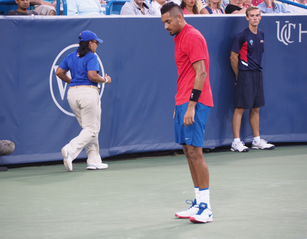 Kyrgios reacts to being unable to get a return in play at deuce in the opening set
