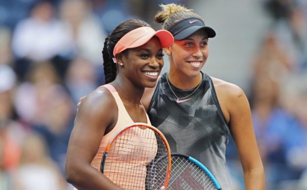 Keys and Stephens all smiles as they meet at the net for the traditional pre-match photos (Elsa/Getty Images)