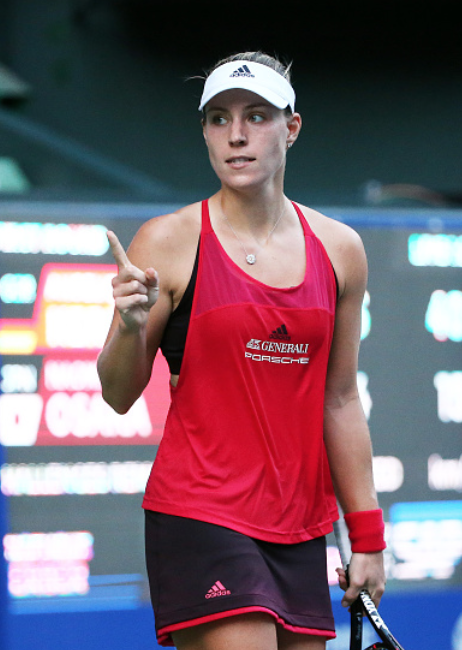 Kerber reacts to taking the opening set against Osaka (Koji Watanabe/Getty Images)