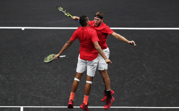Kyrgios and Sock celebrate their win with the classic Bryan Brothers chest bump (Clive Brunskill/Getty Images)