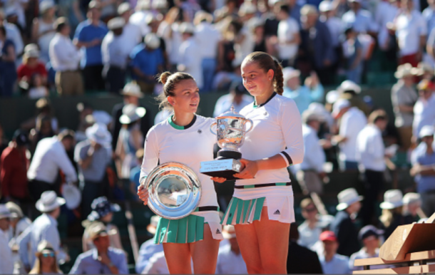 Halep and Ostapenko with their French Open trophies (Tim Clatyon/Corbis/Getty Images)