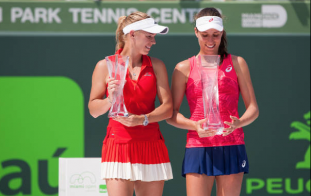 Wozniacki and Konta stand on stage with their titles (Icon Sportswire/Getty Images)