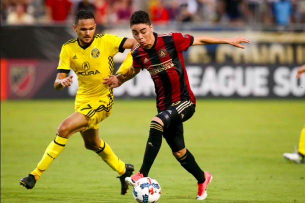 Artur (left) and Miguel Almiron (right) battle for possession. | Photo: Brett Davis - USA Today Sports