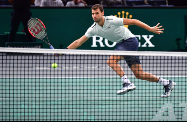 Dimitrov's solid run of form was halted by John Isner in Bercy