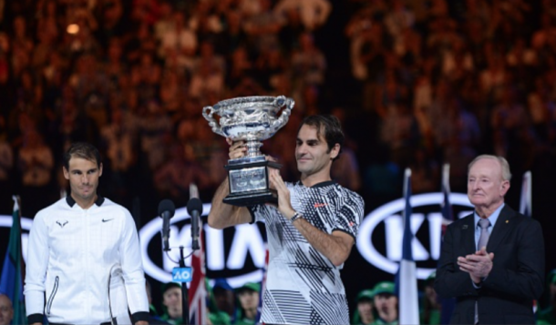 Nadal looks on as Federer lifts the Australian Open title (Anadolu Agency/Getty Images)