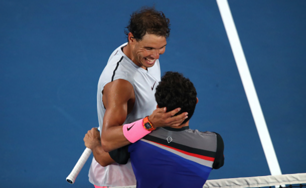 Nadal and Estrella Burgos share a warm embrace at the net (Clive Brunskill/Getty Images)