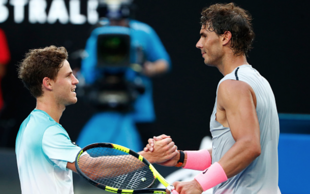 Schwartzman and Nadal share a hug at the net (Michael Dodge/Getty Images)