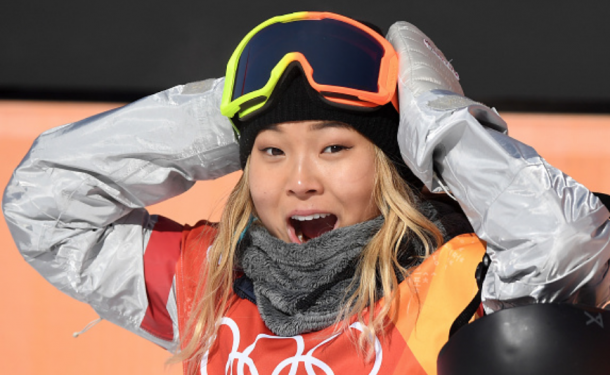 Chloe Kim reacts to her score of a 93.50 in her opening run in the women's halfpipe final (David Ramos/Getty Images)