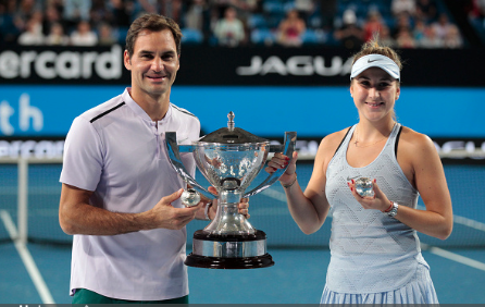 Roger Federer and Belinda Bencic with their Hopman Cup title (David Woodley/Action Plus/Getty Images)