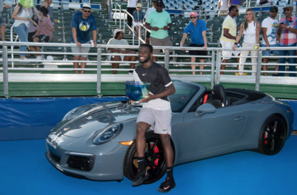 Frances Tiafoe celebrates his first career tour-level title in Delray Beach (Peter Staples/ATP World Tour/Getty Images)
