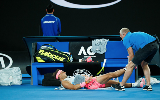 Nadal being treated by the trainer at the Australian Open (Icon Sportswire/Getty Images)