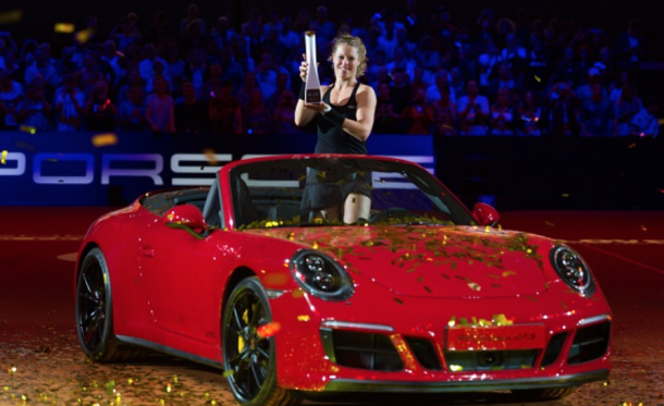 Laura Siegemund lifts her title in a Porsche (Anadolu Agency/Getty Images)