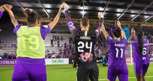 From left to right: Polina (19), Harris (24), Krieger (11) and Ubogagu (6) salute Orlando Pride supporters | Photo: Orlando Pride