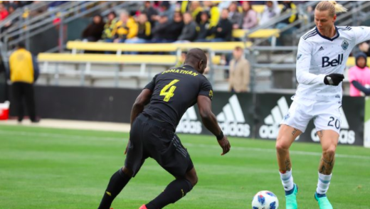 Jonathan Mensah defends Brek Shea of the Vancouver Whitecaps. | Photo: Crew SC