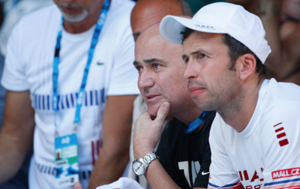 Agassi and Stepanek sitting in Djokovic's box during the Australian Open (Scott Barbour/Getty Images)