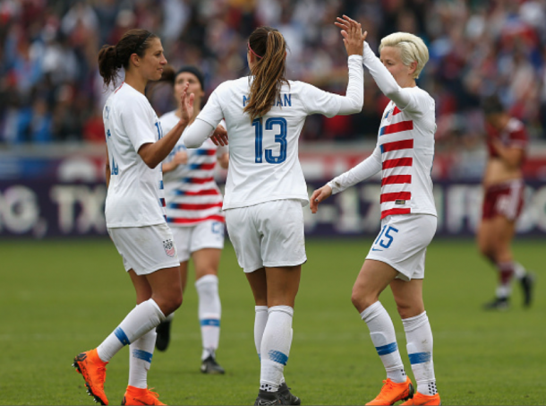 From left to right: Carli Lloyd, Alex Morgan (13) and Megan Rapinoe celebrate a goal against Mexico. (Photo by Tim Warner/Getty Images)
