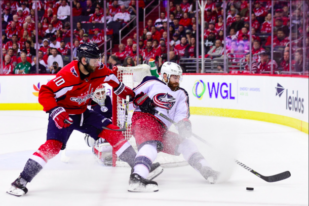 Ian Cole fights for possession of the puck against the Washington Capitals. | Photo: Washington Capitals on Twitter