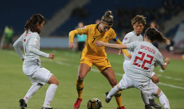 "Seattle Reign FC and Matildas defender Steph Catley gets away from 3 Japan players with a ""Messi"" like move. (Photo by Salah Malkawi/Getty Images)"