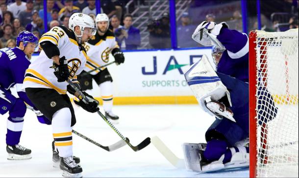 Andrei Vasilevskiy makes a save against Brad Marchand. | Photo: Boston Bruins on Twitter