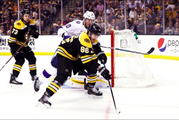 J.T. Miller fights for possession against the Boston Bruins. | Photo: Boston Bruins on Twitter