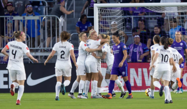Utah Royal FC celebrate the team's first goal in franchise history against the Orlando Pride in Week 1 of the NWSL season. (Photo by Andrew Bershaw/Icon Sportswire via Getty Images)